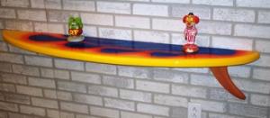 surfboard-wall-shelf-items-on-it